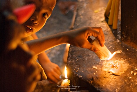 Kids Playing with Candles at Malabon Cemetery