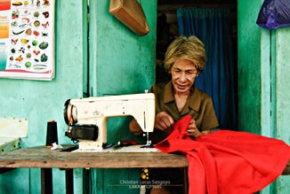 A Coron Old Timer Mends Dresses
