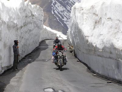 Riding through a corridor of snow near Baralacha La
