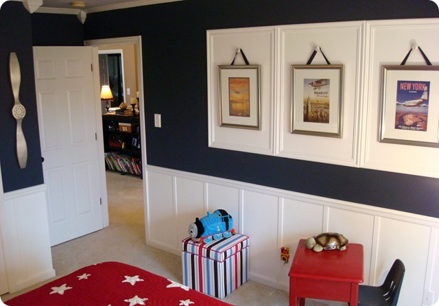 Navy blue walls white board and batten