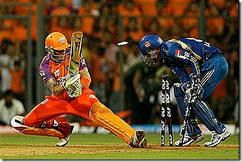 Kochi Tuskers Kerala's Brendon McCullum looks back to see himself being bowled out by Mumbai Indians' Lasith Malinga