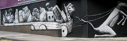 Photograph of Phlegm's piece on the shutters of an abandoned shop on the Moor.