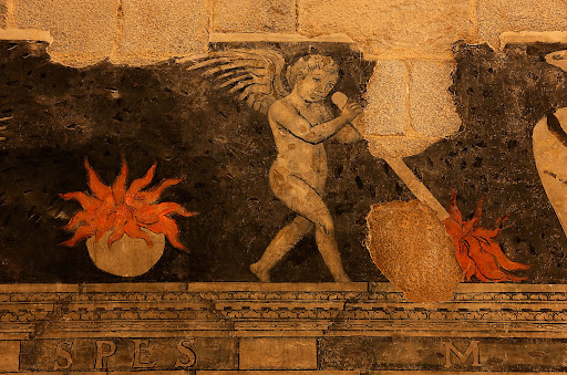Pintures murals renaixentistes i tomba de Joan Despés, bisbe d'Urgell, s. XVI, torxes cap per avall, símbol funerari renaixentista. Catedral de la Seu d'Urgell.La Seu d'Urgell, Alt Urgell, Lleida