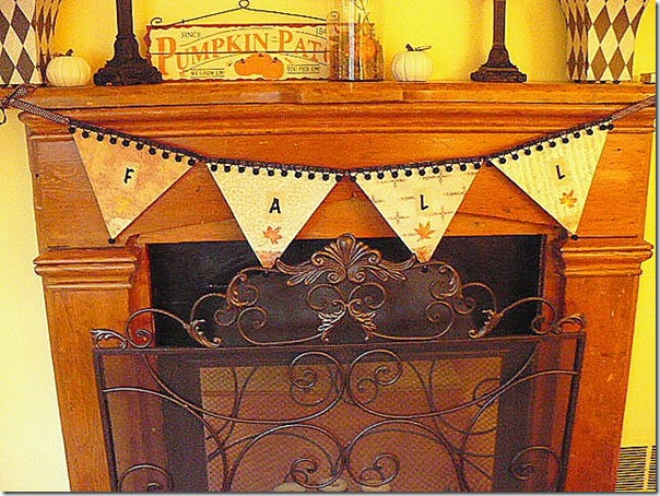 handmade fall banner on fireplace mantel