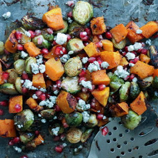 Garlic Chili-Maple Roasted Butternut Squash & Brussels Sprouts with Pomegranate + Gorgonzola.