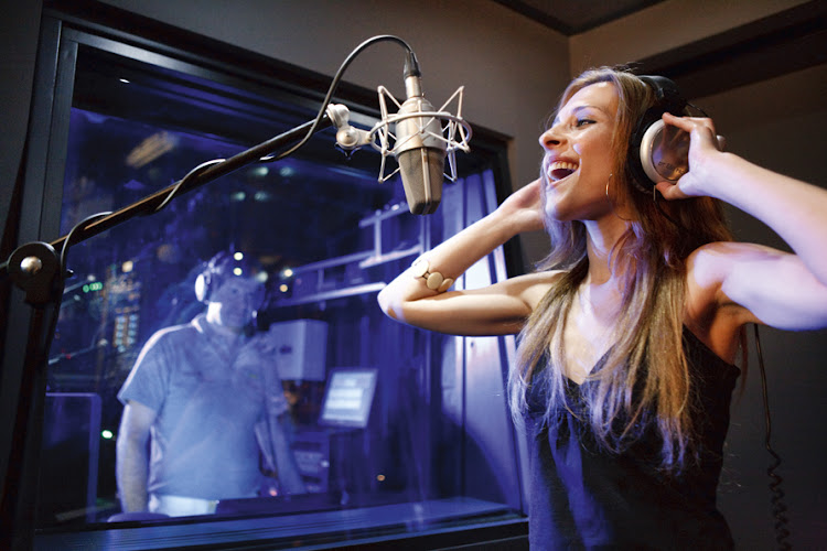Take karaoke singing a step further in Costa Pacifica's recording studio.