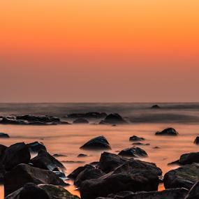 Sunset reflection by Charanjit Singh - Landscapes Sunsets & Sunrises ( sunset, beautiful, long exposure, ocean, landscape, photography )