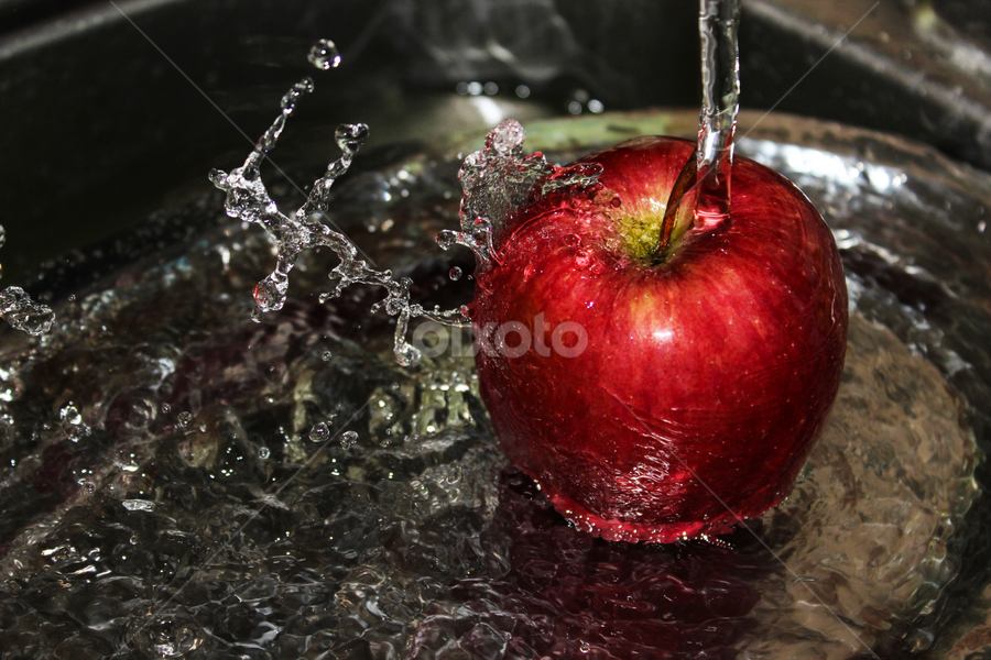 Apple splash by Suzana Trifkovic - Food & Drink Fruits & Vegetables ( water, fruit, nutrient, splash, nutritious, splash water photography, splashed, nutrition, red, splashing, apple, food, wet,  )
