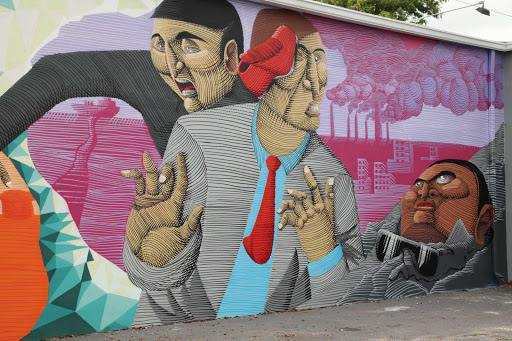 Miami-Wynwood-Walls-Mural - Not all art is created by the dead masters. There's street art, the people's art, as well. Here's a mural in the Wynwood Art District in Miami.