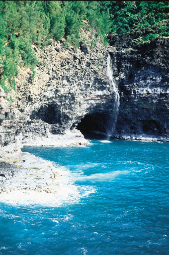 sea-caves-Napali-Coast - Waterfall and sea caves along Kauai's Na Pali Coast.