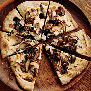 Mushroom–and–Goat Cheese Béchamel Pizzas.