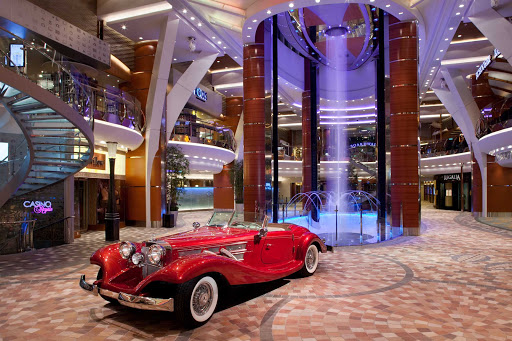 Allure-of-the-Seas-Royal-Promenade - Walk along the Royal Promenade on Allure of the Seas and check out the replica of a classic Morgan Sportster before heading to one of several dining spots.