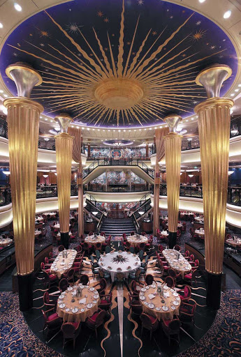 Explorer-of-the-Seas-Dining-Room - A grand view of the impressive three-level main dining room on Explorer of the Seas.