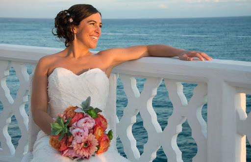 A bride in the late afternoon glow at Curtain Bluff Resort in Antigua and Barbuda, a popular venue for weddings.