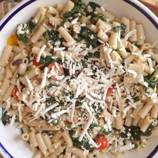 Gluten-Free Pasta with Ricotta Salata, Garlicky Spinach, Tomatoes, and Olives.