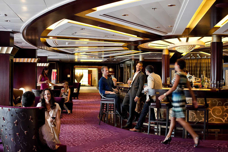 Mingle and meet new people over drinks in Celebrity Solstice's Ensemble lounge.
