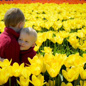 Brotherly Love by Jason Weigner - Babies & Children Children Candids ( hug, moods, passionate, sun coming through wildflowers, children, yellow, people, spring, child, love, flowers, passion, enthusiasm, kids, improving mood, portrait, human, emotion, kids in the summer, field, kids playing in summer, spring colorful flowers, red, tulip, outdoors, boy, springtime, the mood factory, inspirational,  )