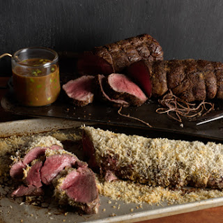 Porcini-Crusted Beef Tenderloin with Truffle Butter Sauce.