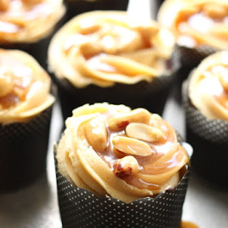 Chocolate Cupcakes with Peanut Butter Cream Cheese Frosting and Caramel Peanut Glaze aka Snickers Cupcakes.