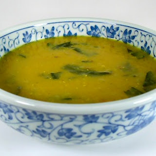 Curried Red Lentil Soup with Dandelion Greens.