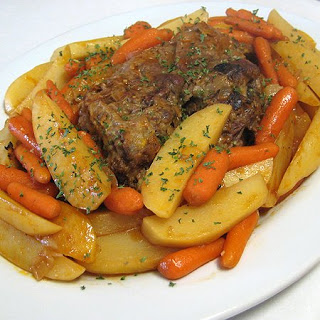 Oven Baked Pot Roast with Potatoes and Carrots.