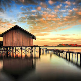 Sunset in Sentani Lake by Geoffrey Saturnus - Buildings & Architecture Homes