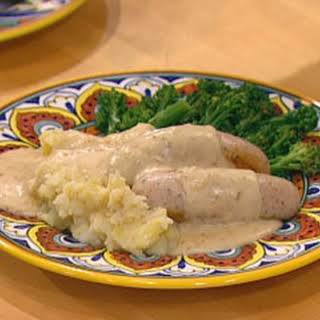 (Veal) Bockwurst In A Creamy Mustard Sauce With Smashed Potatoes & Broccolini.