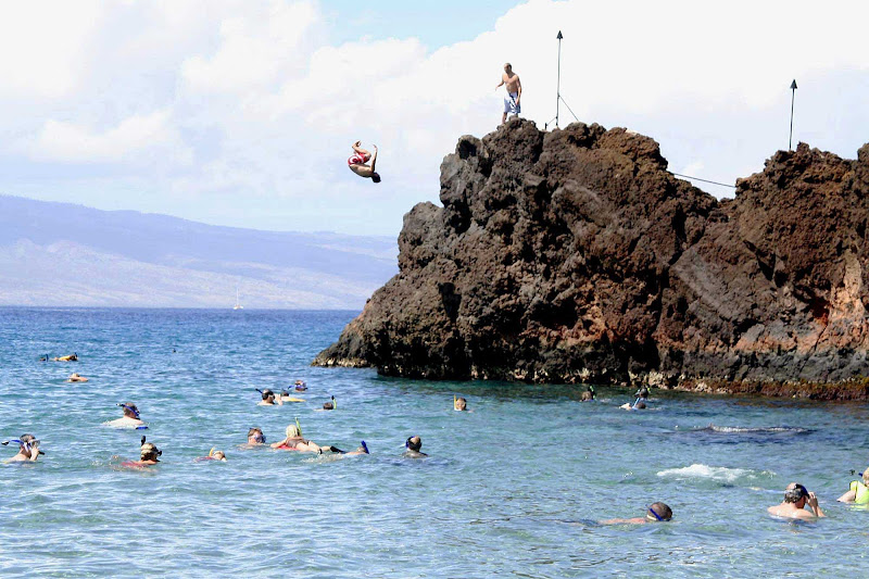 Black Rock, bordering one end of marvelous Kaanapali Beach on Maui, attracts snorkelers and cannon-ballers.