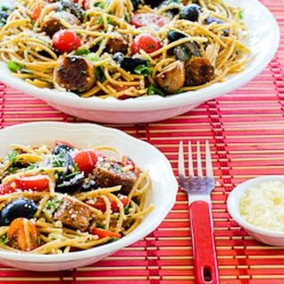 Whole Wheat Spaghetti Salad with Italian Sausage, Tomatoes, Olives, and Basil Vinaigrette.