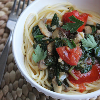 Spaghetti With Spinach in a White Wine Garlic Sauce.