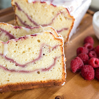 Fresh Raspberry Swirl & Greek Yogurt Cake with Tangy Yogurt Drizzle