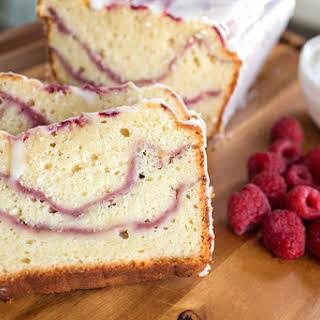 Fresh Raspberry Swirl & Greek Yogurt Cake with Tangy Yogurt Drizzle.