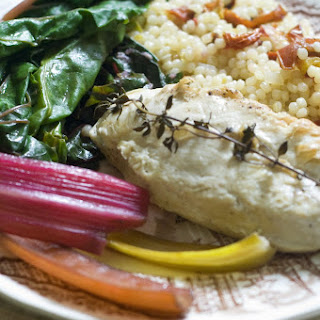 Pan Seared Chicken over Israeli Couscous with Roasted Tomatoes and Swiss Chard