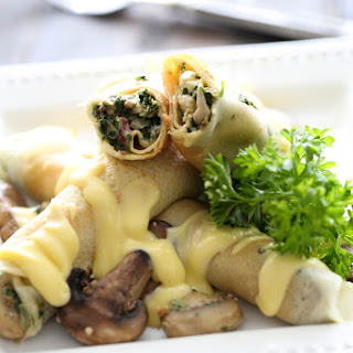 Spinach Bacon Crepes with Hollandaise Sauce.