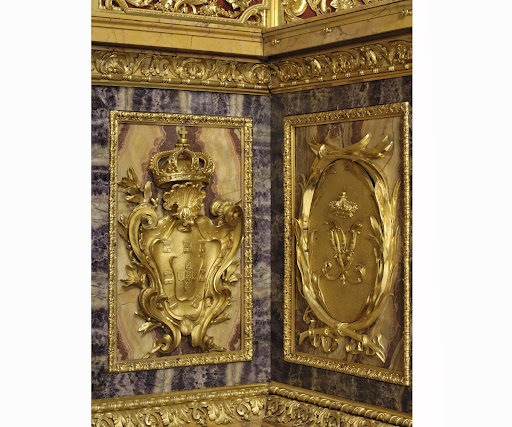 Gilt metal coat of arms and royal monogram decorating the sides of the altar, Chapel of Saint John the Baptist