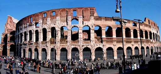 Colosseum-panoramic-Rome - The Colosseum in Rome was long the largest amphitheater in the word, holding 50,000 to 80,000 spectators who watched gladiatorial contests and public spectacles. It was built between 70 AD and 80 AD.