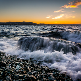 Windy evening in Bergen, Norway by Paulius Bruzdeilynas - Landscapes Waterscapes ( clouds, bergen, water, wind, mountain, splash, windy, waves, stone, rock, beach, norway, city, fjord, sunset, wave, norge, down )