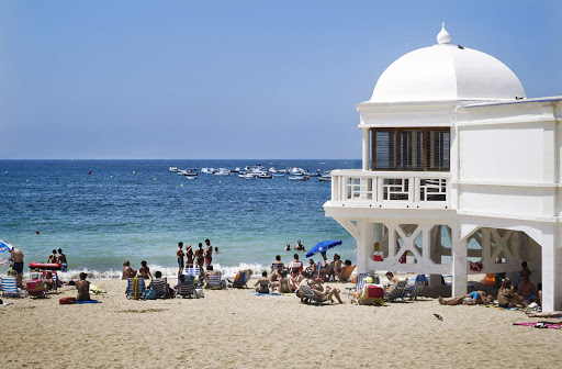 La Caleta beach, in the historical center of the port of Cádiz in southwestern Spain, is popular with locals and travelers during the summer months. Cádiz, capital of Cádiz province, boasts a scenic coastline and rich culture.