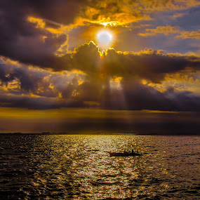 humble fisherman under beautiful cloudy sunset by Ariel Ladrido - Landscapes Sunsets & Sunrises ( humanity, society, sunset, sea, cloud formation, landscape, boat, people, crowd, sun rays )