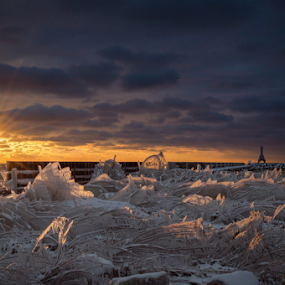 Fire and Ice by James Meyer - Landscapes Sunsets & Sunrises ( clouds, ice, sunset, dramatic, lighthouse, sunrise, frozen, fire, , golden hour )