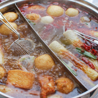Chinese-Style Hot Pot With Rich Broth, Shrimp Balls, and Dipping Sauces.
