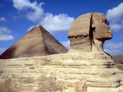 Cairo-Sphinx - The Sphinx and the Great Pyramid of Khufu at Cairo, Egypt.