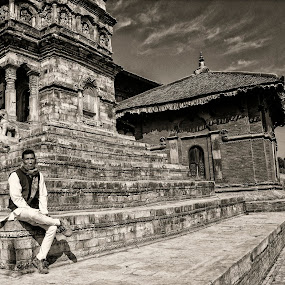 Lonely man by Nguyen Kien - People Street & Candids ( sitting, durbar square, black and white, nepali, man )