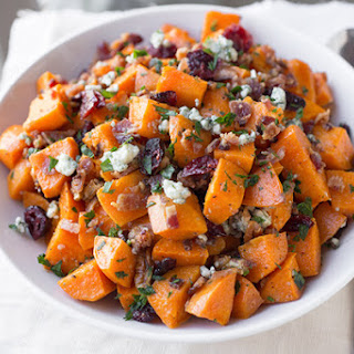 Warm Roasted Sweet Potato Salad with Apple-Smoked Bacon, Blue Cheese, Dried Cranberries and Pecans in Warm Bacon-Herb Vinaigrette.