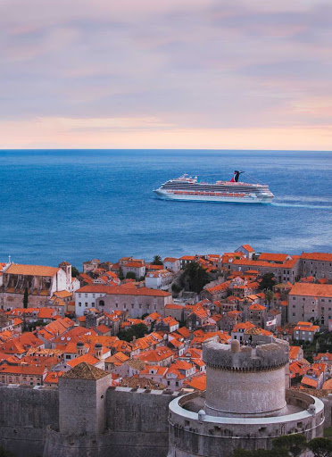 Carnival Freedom sails along the picturesque coast of Dubrovnik, Croatia.