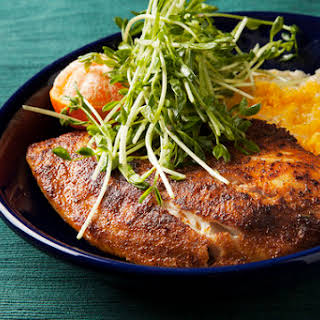 Blackened Tilapia with Cheddar Grits & Pea Shoots.