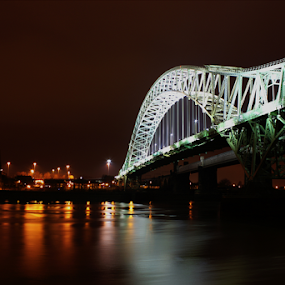 Night Reflections at the Runcorn Bridge in Cheshire, UK by Mandy Jervis - Buildings & Architecture Bridges & Suspended Structures ( runcorn bridge cheshire uk structure road roadway night lights reflections river mersey span crossing metal iron arch )
