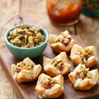 Baked Brie Puffs with Fruit Preserves and Pistachios.