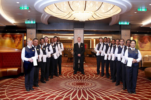 Royal-Caribbean-wait-staff - The staff in the dining rooms on Royal Caribbean cruises are charged with making sure that all dishes meet exacting standards.
