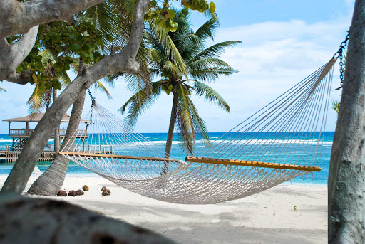 Cayman-Islands-hammock-Brac-Reef-Beach-Resort - The Brac Reef Resort features hammocks on the beach of Cayman Brac.